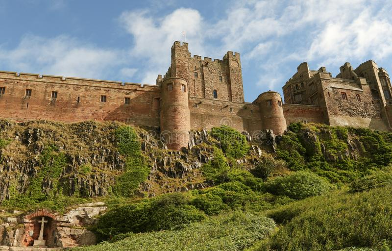 A War Memorial set in an alcove in rock below Bamburgh Castle in Northumberland England . royalty free stock images