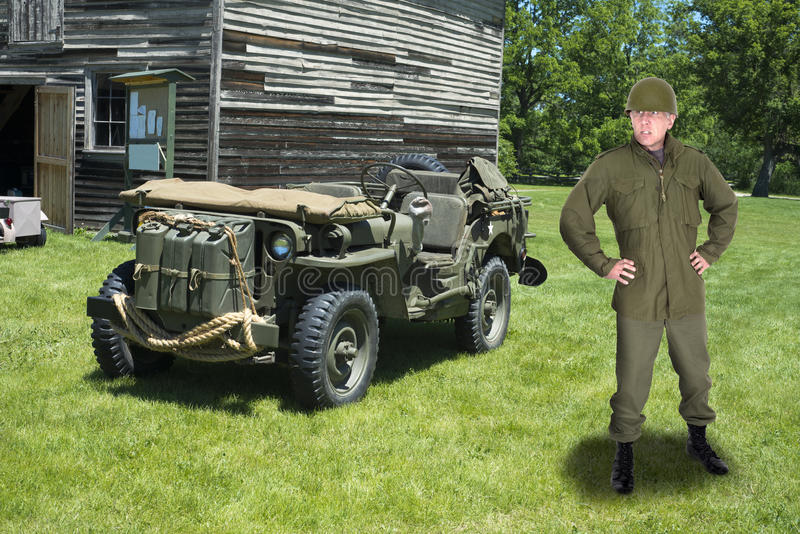 War, Military Army Officer and Retro Jeep Vehicle. A military army officer wearing combat fatigues is standing in the field in front of a jeep. The leader is royalty free stock photos