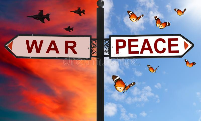 War or peace choice on a signpost with arrows in two opposite directions. Red dramatic sunset sky with flying jets against calm bl royalty free stock photo