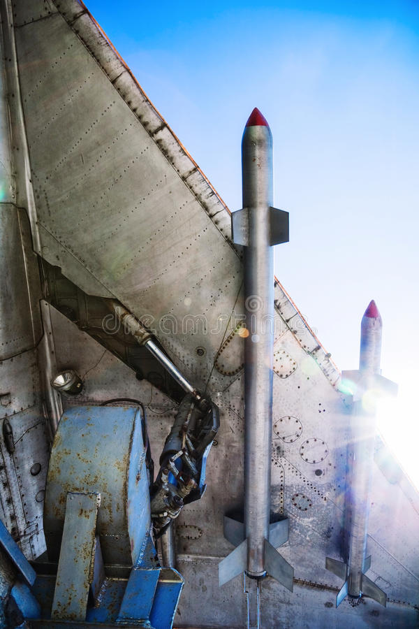 War-plane wing. With missiles at sunlight. Bottom view stock photos