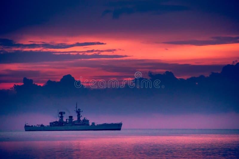 War ship sunset, Beautiful sunset on the beach, Sunset lake land royalty free stock photo