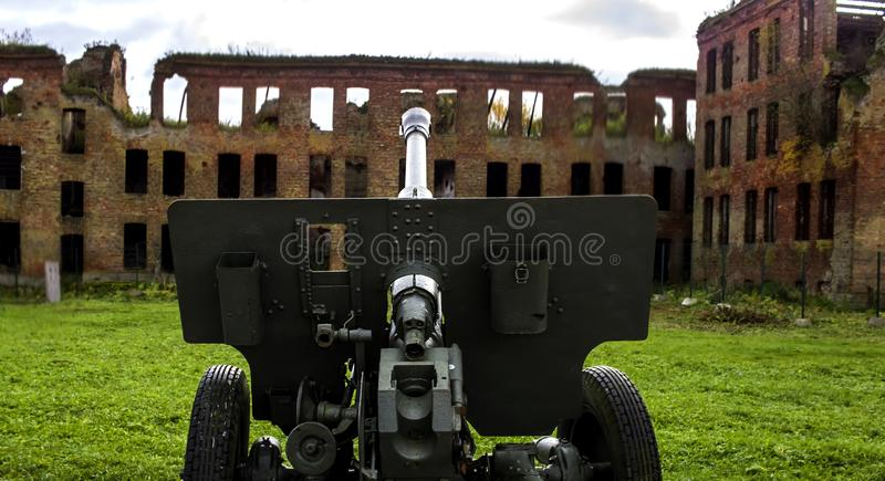A war-torn brick building. A cannon, a sight at an apartment house. Ruins and ruins, broken glass. royalty free stock photo