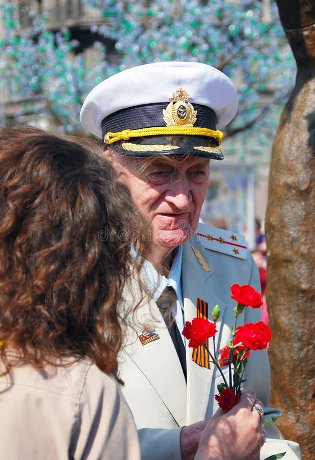 War Veteran Recieves Flowers Editorial Image