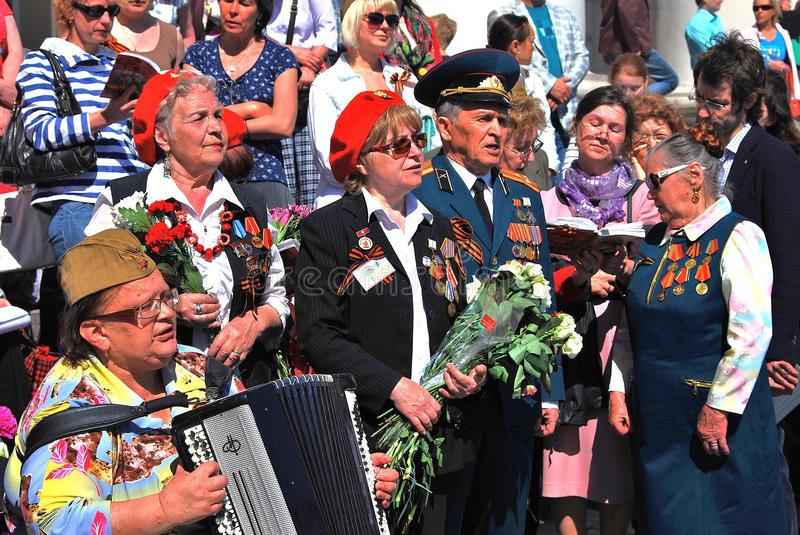 War veterans sing songs on Theater Square, by Bolshoi theater in Moscow. MOSCOW - MAY 09, 2014: War veterans sing songs on Theater Square, by Bolshoi theater in royalty free stock photo
