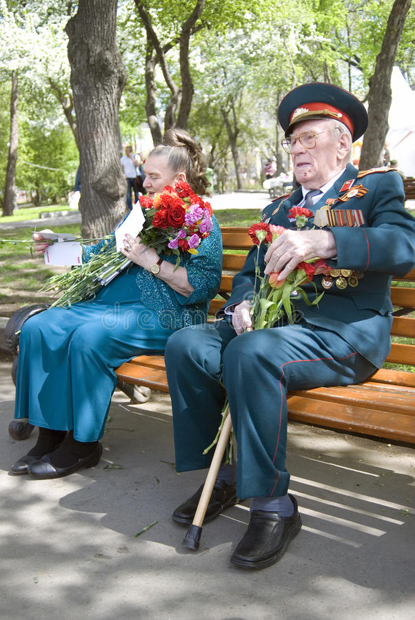 War veterans woman and man portrait. MOSCOW - MAY 09, 2015: War veterans woman and man portrait. Victory Day celebration in Moscow stock image
