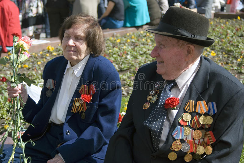 War veterans woman and man portrait. MOSCOW - MAY 09, 2015: War veterans woman and man portrait. Victory Day celebration in Moscow royalty free stock photos