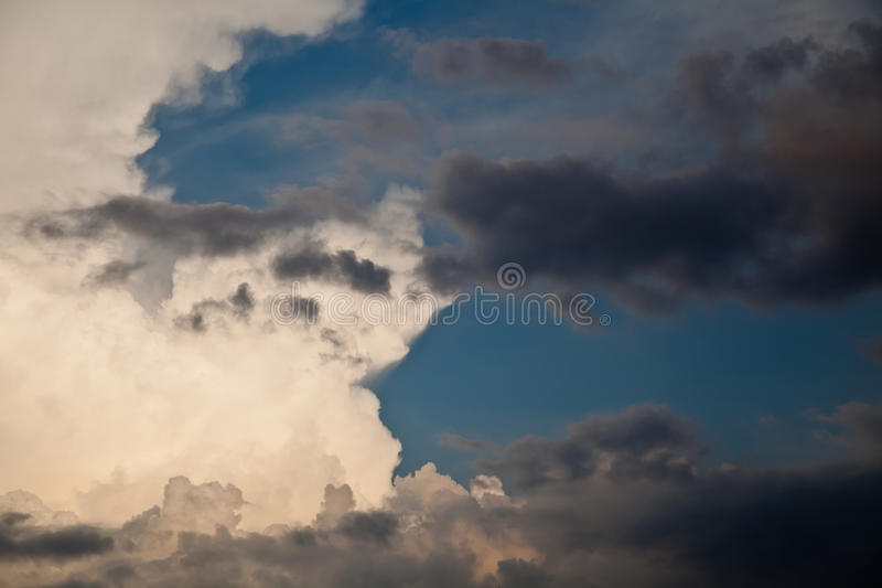 War of white and black clouds royalty free stock photography