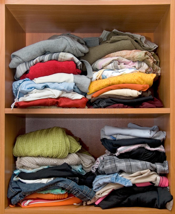 Wardrobe. Woman's wardrobe inside with pile of clothes stock image