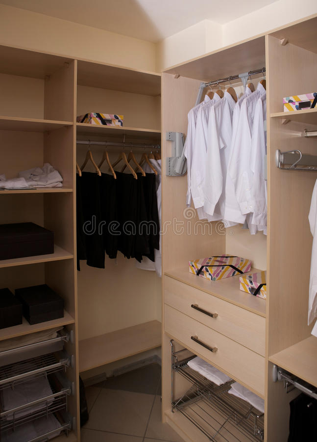Wardrobe. With hangers and boxes stock images