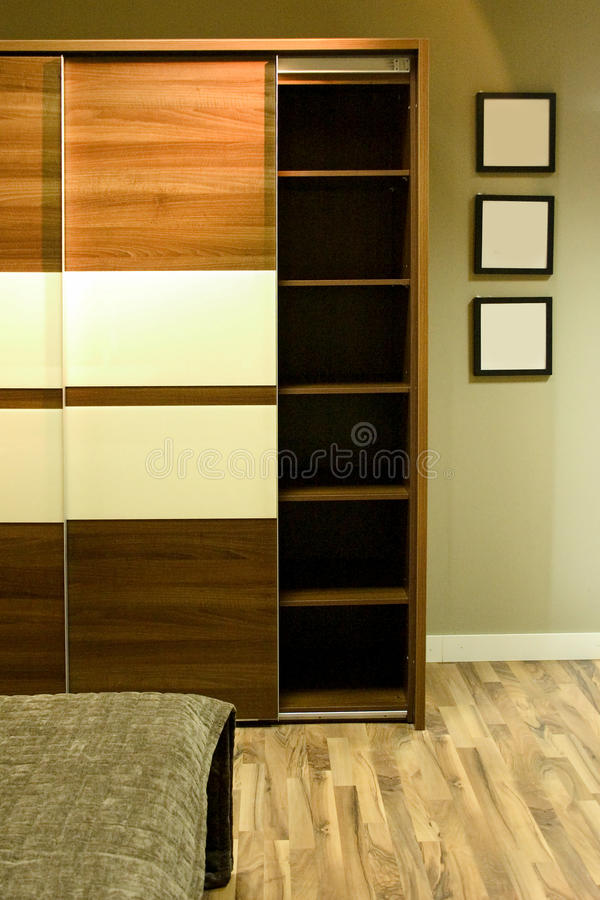Wardrobe. With three photo frames on the wall royalty free stock image