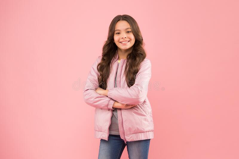 Wardrobe for autumn or spring season. Fashion trend and style. Kids essential for outdoor activities. Casual brings joy. Happy girl in casual wear pink royalty free stock images
