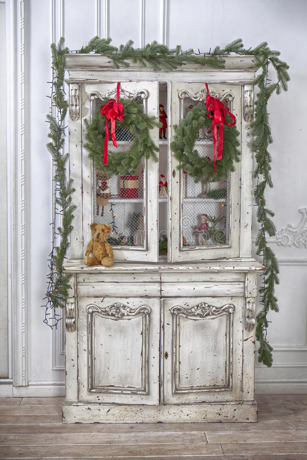 Wardrobe with Christmas toys and Christmas tree garland stock image