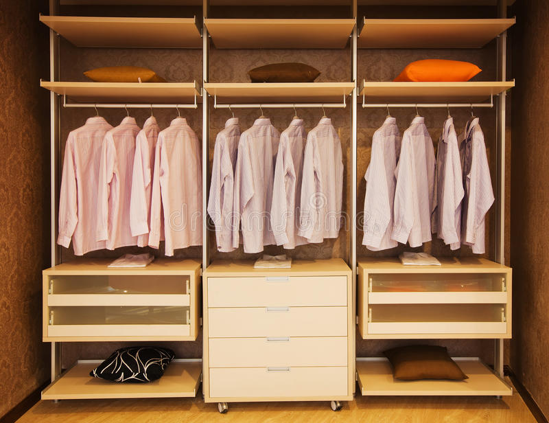 Wardrobe. Detail of built in wardrobe with open shelves stock image