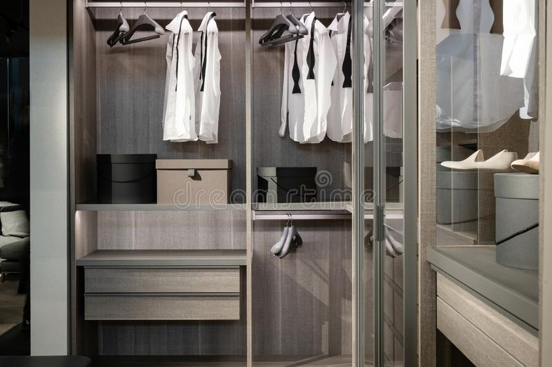 Wardrobe with different stuff, shoes and male clothes stock image