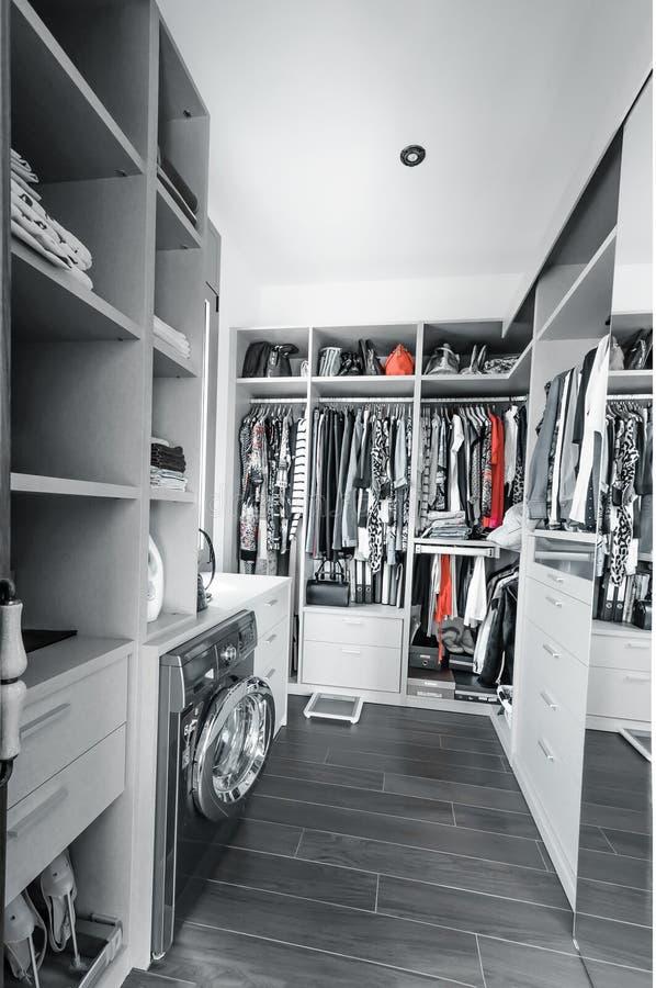 Wardrobe with organized clothing royalty free stock photo