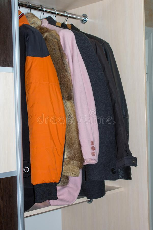 Wardrobe with winter clothes,an open wardrobe with the upper winter clothes in the room stock image