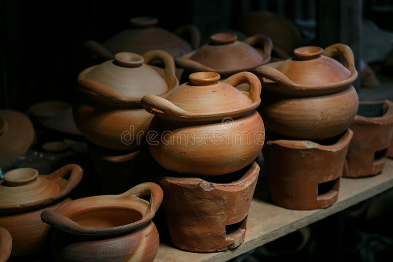 Ware pots and stove. On shelf royalty free stock image