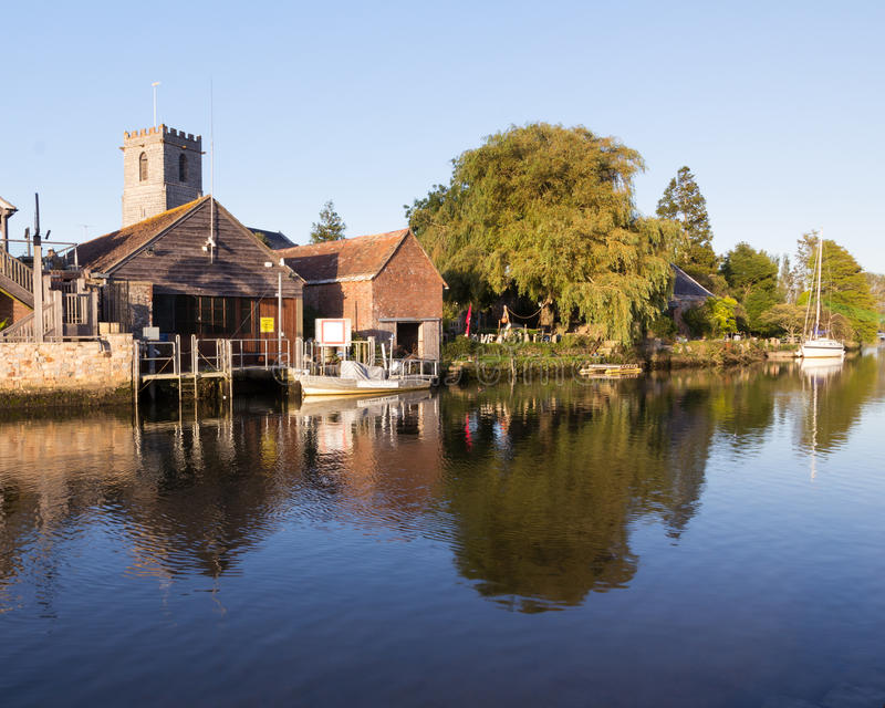 Wareham Dorset. Wareham Quay Dorset England on the River Frome with the Old Granary and the Church of Lady St. Mary stock photo