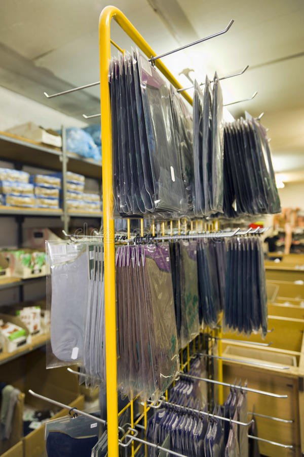 At the warehouse. With clothes royalty free stock images