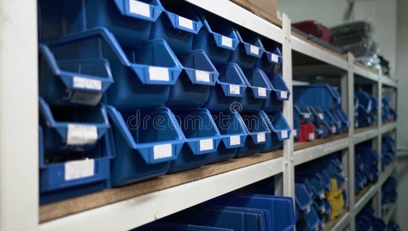 Warehouse Blue Boxes Factory. Store Shelfs Descriptions stock photo