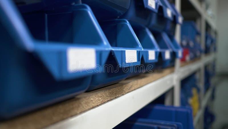 Warehouse Blue Boxes Factory. Store Shelfs Descriptions royalty free stock image