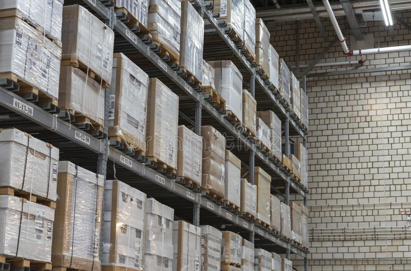 Warehouse with boxes on shelves and racks royalty free stock photos