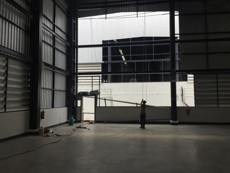 A warehouse is a commercial building for storage of goods. Logistics, perspective, plant, modern, architecture, iron, lamp, large, light, room, space royalty free stock photo
