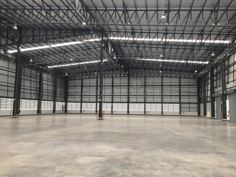 A warehouse is a commercial building for storage of goods. Logistics, perspective, plant, modern, architecture, iron, lamp, large, light, room, space stock photos
