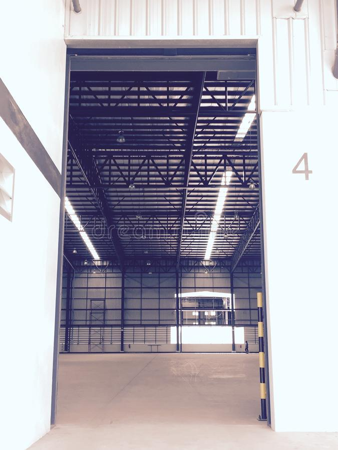 A warehouse is a commercial building for storage of goods. Logistics, perspective, plant, modern, architecture, iron, lamp, large, light, room, space royalty free stock photos