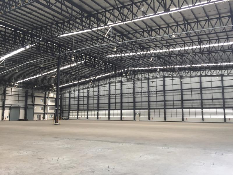 A warehouse is a commercial building for storage of goods. Logistics, perspective, plant, modern, architecture, iron, lamp, large, light, room, space stock image