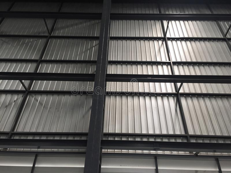 A warehouse is a commercial building for storage of goods. Logistics, perspective, plant, modern, architecture, iron, lamp, large, light, room, space stock photography