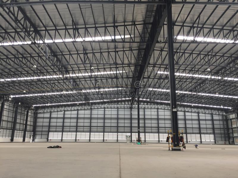 A warehouse is a commercial building for storage of goods. Logistics, perspective, plant, modern, architecture, iron, lamp, large, light, room, space royalty free stock images