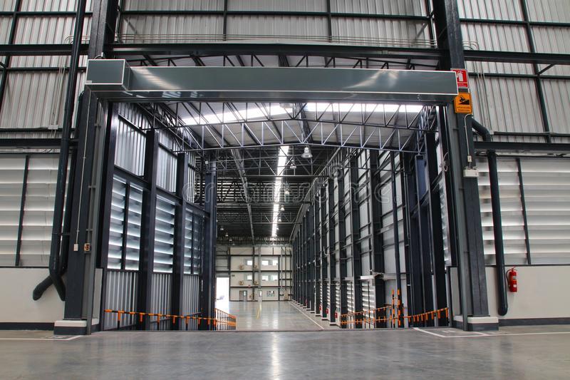A warehouse is a commercial building for storage of goods. Warehouses are used by manufacturers, importers, exporters, wholesalers, transport businesses stock image