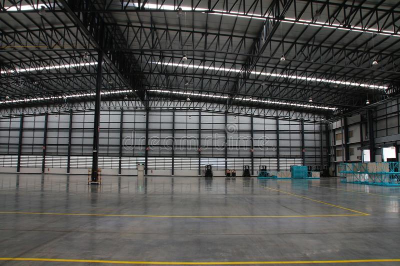 A warehouse is a commercial building for storage of goods. Warehouses are used by manufacturers, importers, exporters, wholesalers, transport businesses stock photo