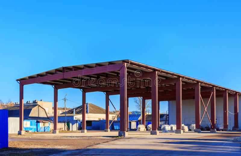 A warehouse is a commercial building for storage of goods. Warehouses are used by manufacturers, importers, exporters. Wholesalers, transport businesses stock image