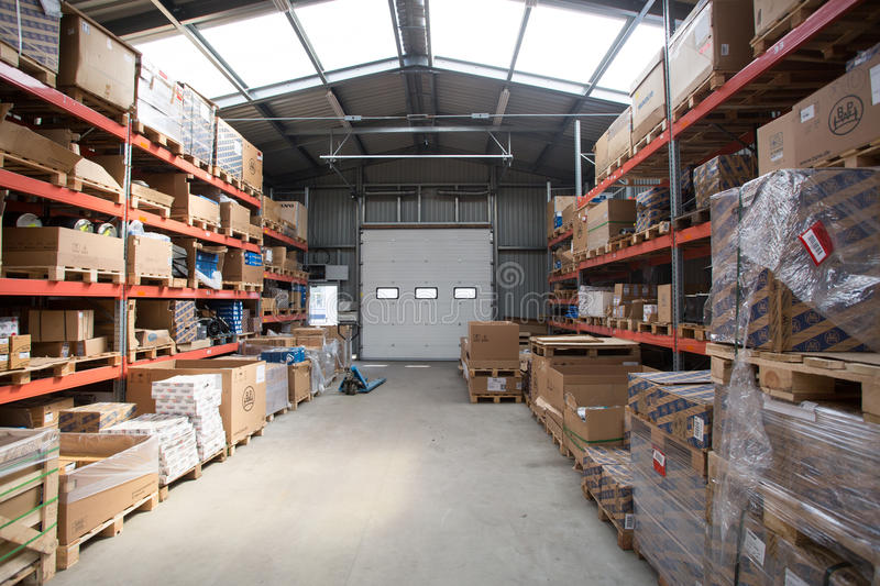 A warehouse is a commercial building for storage of goods. Warehouses are used by manufacturers, importers, exporters, wholesalers royalty free stock images