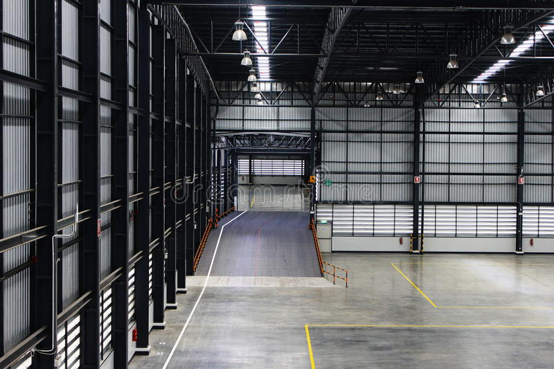 A warehouse is a commercial building for storage of goods. Warehouses are used by manufacturers, importers, exporters, wholesalers, transport businesses stock images