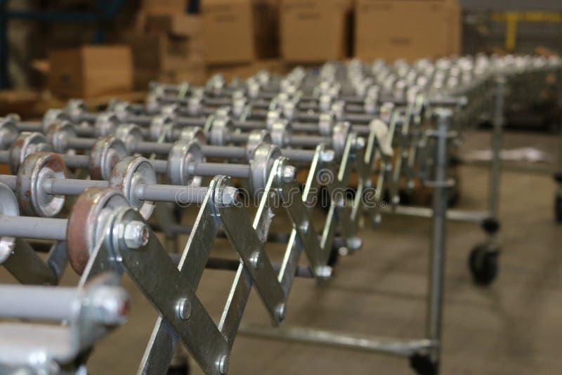 Warehouse conveyor belt. Old-fashioned conveyor belt for warehouse assembly line stock images