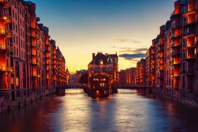 The Warehouse district Speicherstadt during twilight sunset in Hamburg, Germany. Illuminated warehouses in Hafencity quarter in stock photos