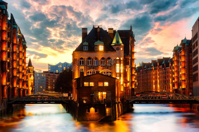 The Warehouse district Speicherstadt during twilight sunset in Hamburg, Germany. Illuminated warehouses in Hafencity quarter in royalty free stock photos