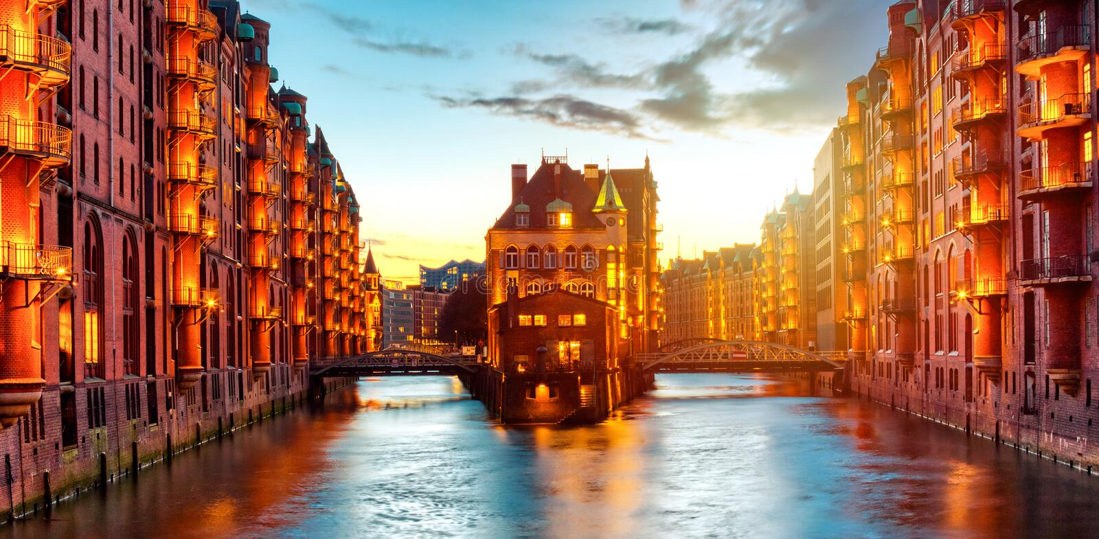 The Warehouse district Speicherstadt during twilight sunset in Hamburg, Germany. Illuminated warehouses in Hafencity quarter in stock image