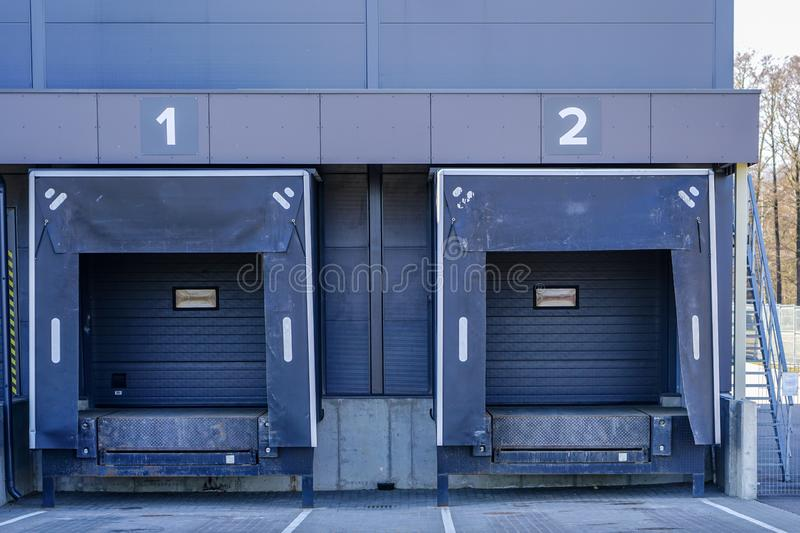 Warehouse dock with thermally insulated gate to minimize temperature change. Of the load when loading royalty free stock images