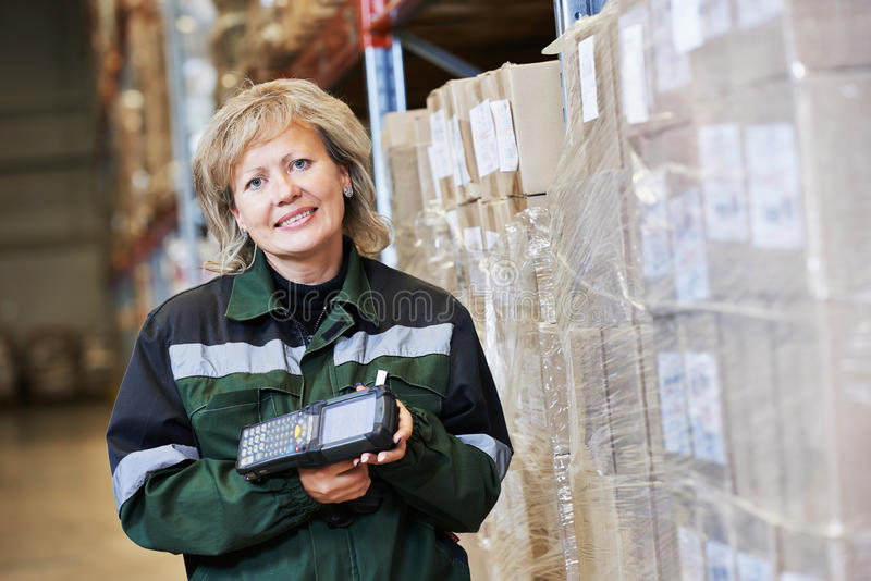 Warehouse female worker at work stock image