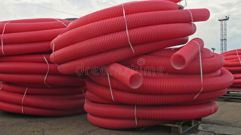 Warehouse of finished plastic pipes industrial outdoors storage site. Manufacture of plastic water pipes factory. royalty free stock images