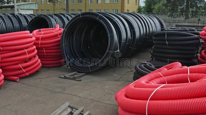 Warehouse of finished plastic pipes industrial outdoors storage site. Manufacture of plastic water pipes factory. royalty free stock photos