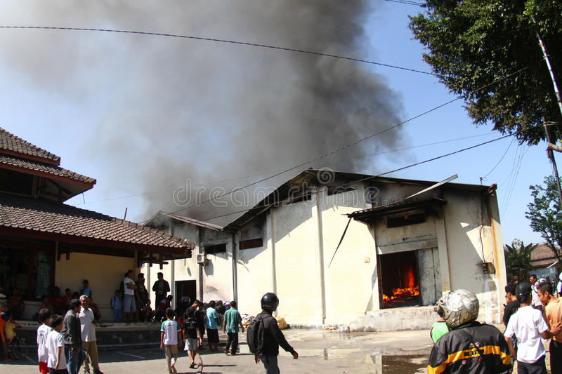 Warehouse on fire. Residents and the firemen tries to extinguish charmingly flaring up in a warehouse in solo, central java, indonesia stock photo