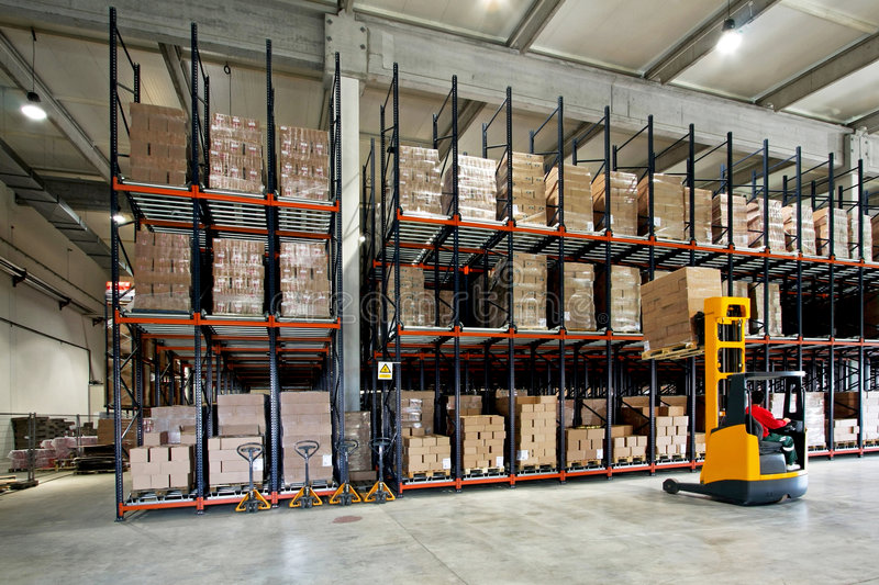 Warehouse forklifter stock photography