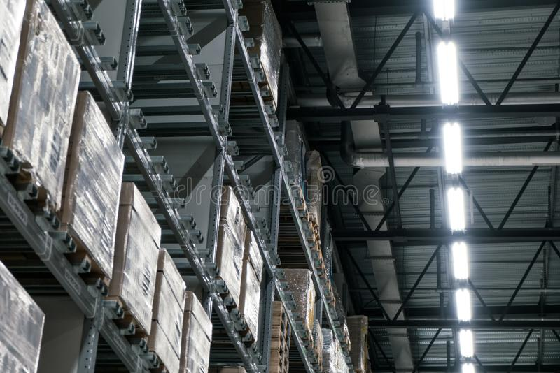 The warehouse full of goods, boxes and shelves in order royalty free stock photos