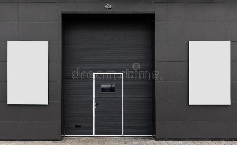 Warehouse gate, advertising space. dark background, white banner stock photo