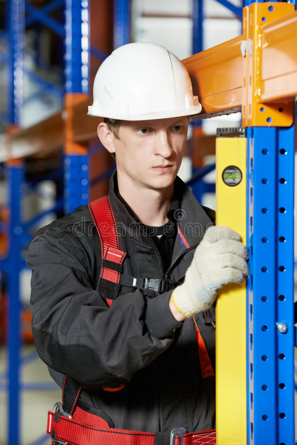 Warehouse installer worker examining quality royalty free stock images